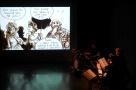 Avignon theatre de la rotonde  concert bd du groupe Zenzika avec en fond la bd Championzé